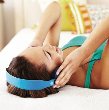 Woman listening to music on Simmons Beautyrest mattress